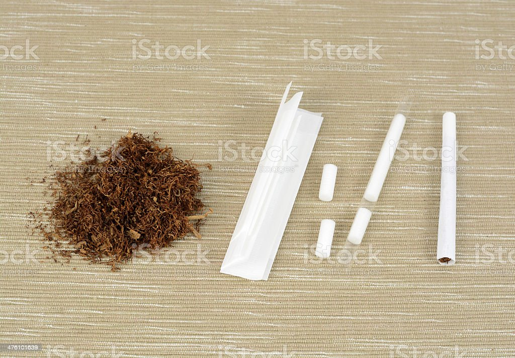 Hand Rolling Cigarette stock photo