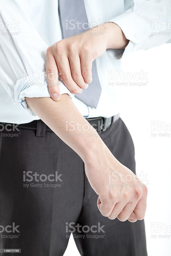 hand rolling sleeves up stock photo