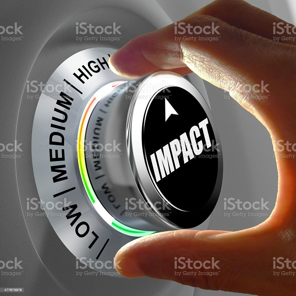 Hand rotating a button and selecting the level of impact. stock photo