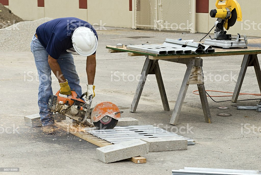 Hand Sawing Metal Studs royalty-free stock photo
