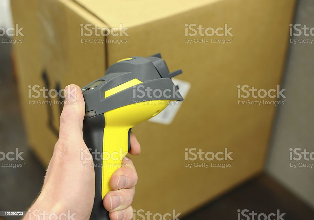 Hand scanner and box stock photo
