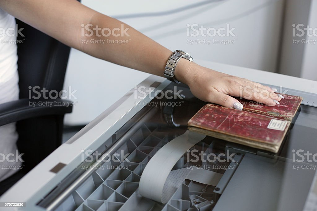 Hand scanning a book stock photo