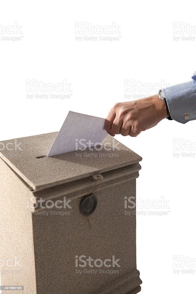 Hand sending a letter in a mail box stock photo