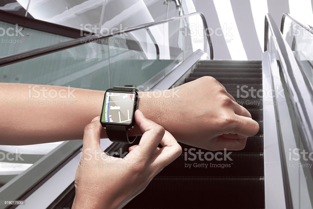 Hand setting route for GPS on the smart watch stock photo