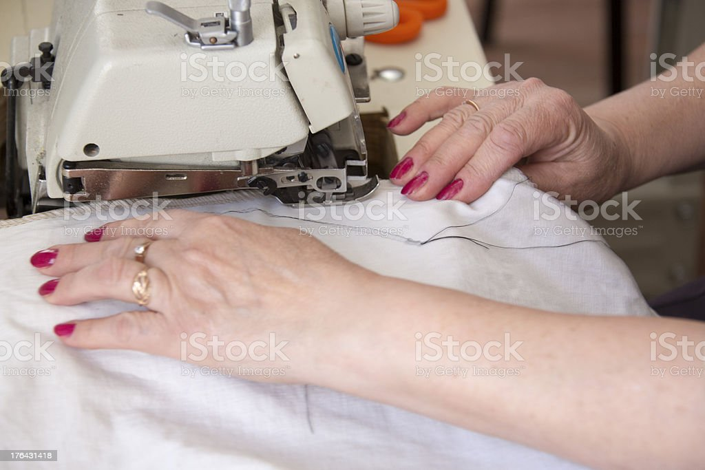 Hand sewing on a machine stock photo