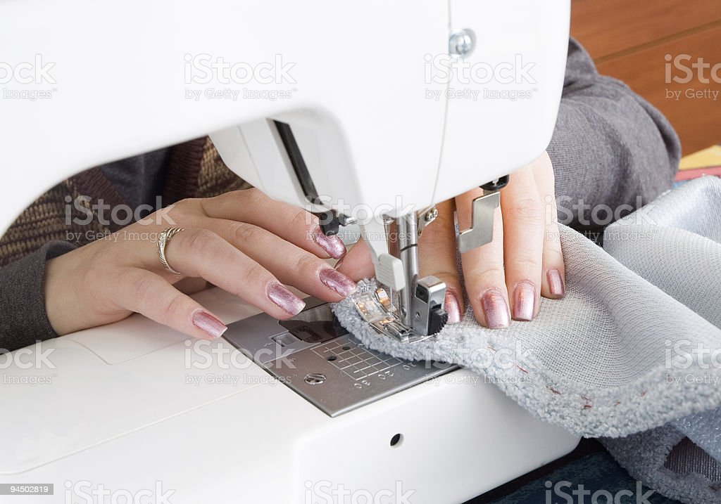 Hand sewing on a machine royalty-free stock photo