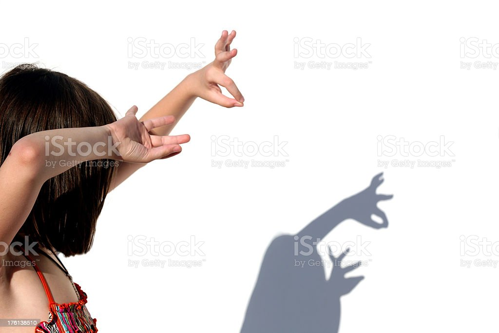 Hand shadows onto the wall royalty-free stock photo