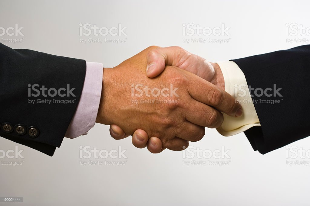 Hand shake with men in black suits royalty-free stock photo