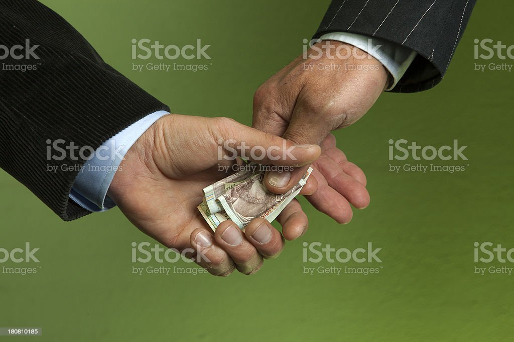 Hand shake with money involved royalty-free stock photo