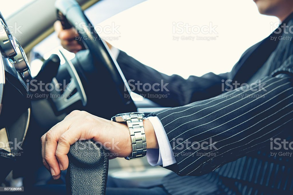 Hand shifting the gear stick stock photo