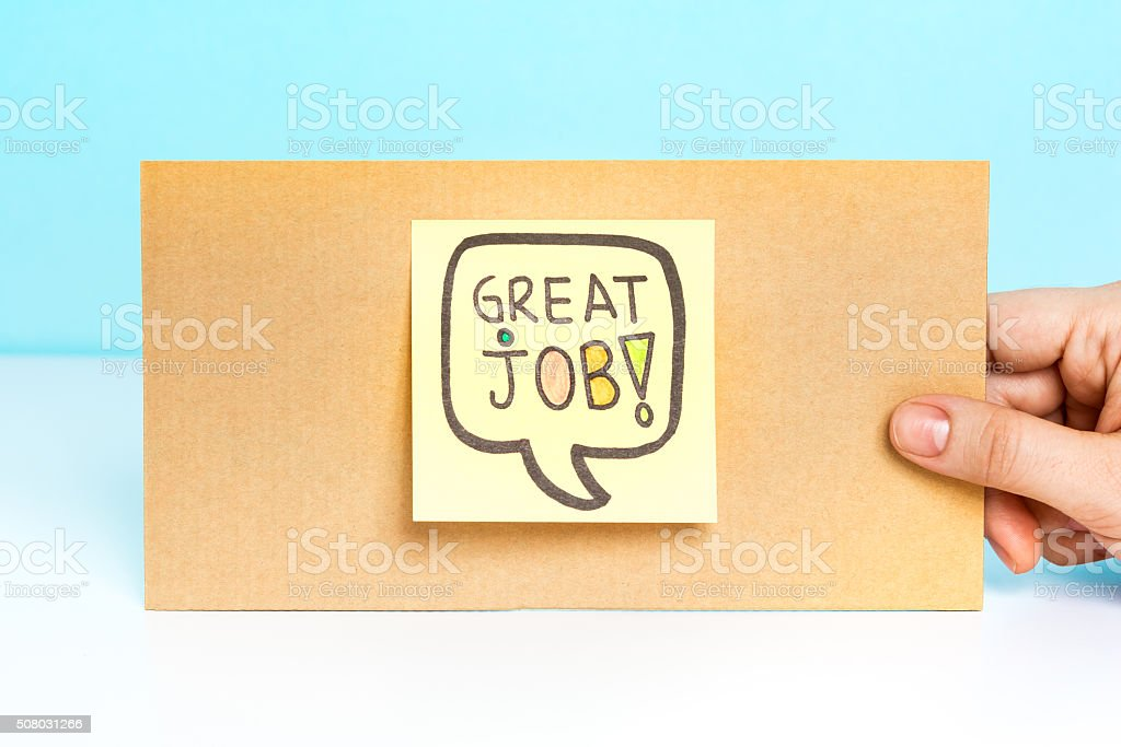 Hand showing a message with Great job! stock photo