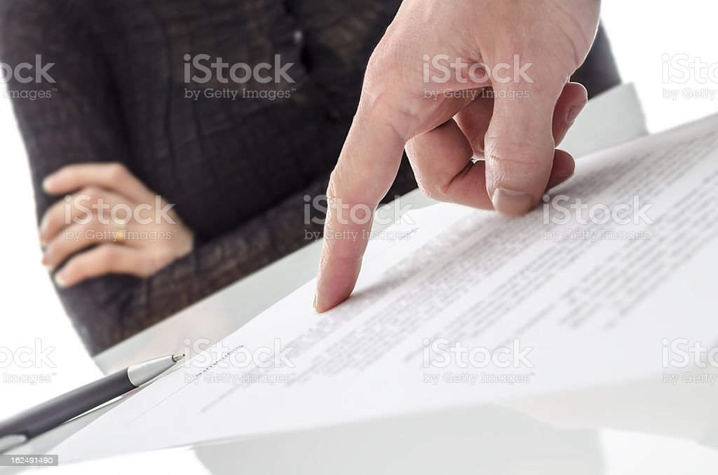 Hand showing a woman to sign the document stock photo