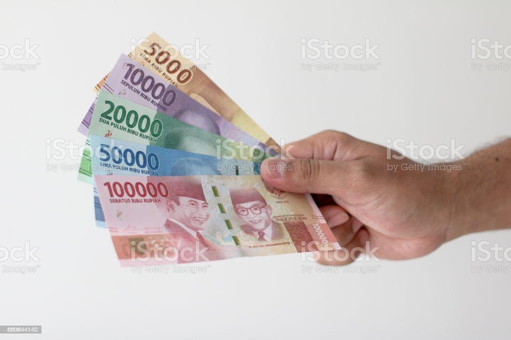 hand showing Indonesia Money Rupiah stock photo