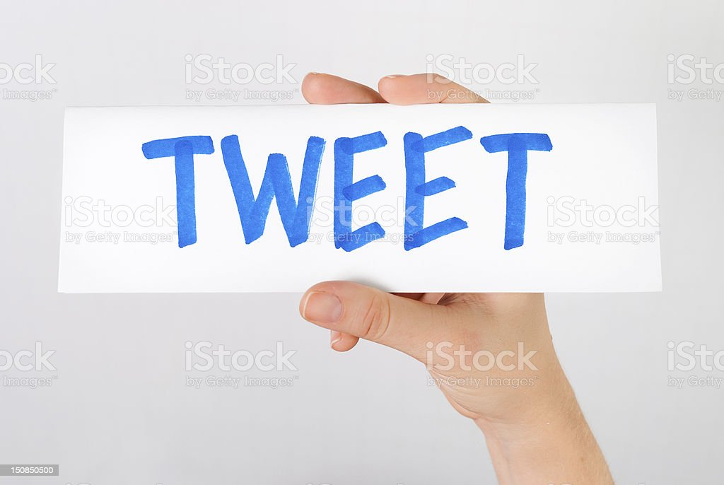 Hand showing tweet word royalty-free stock photo