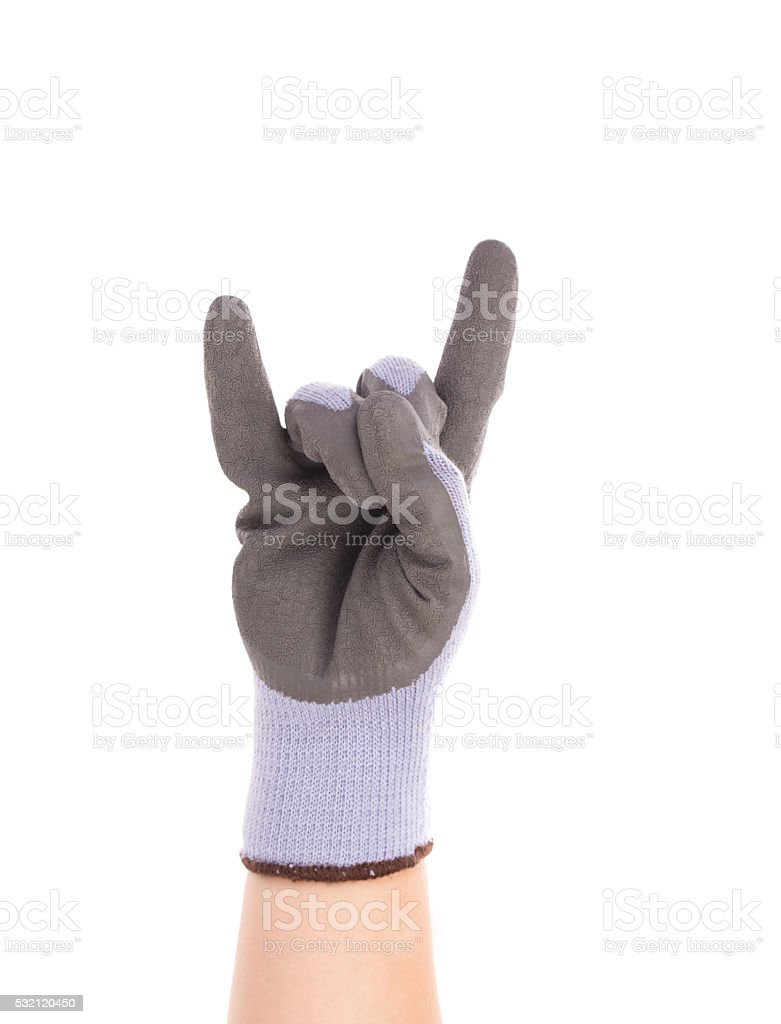 Hand shows rock sign in rubber glove. stock photo