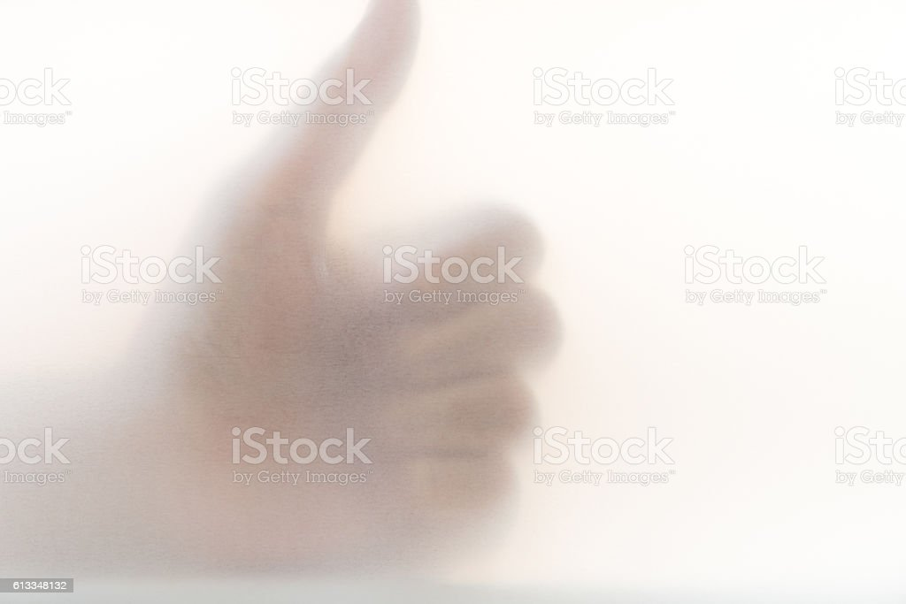 Hand sign 'Like or Good' , Blur bacguound. stock photo