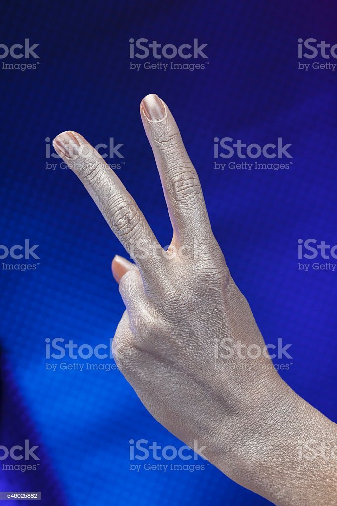 Hand sign  Number two Sign of victory   Silver metal futuristic stock photo