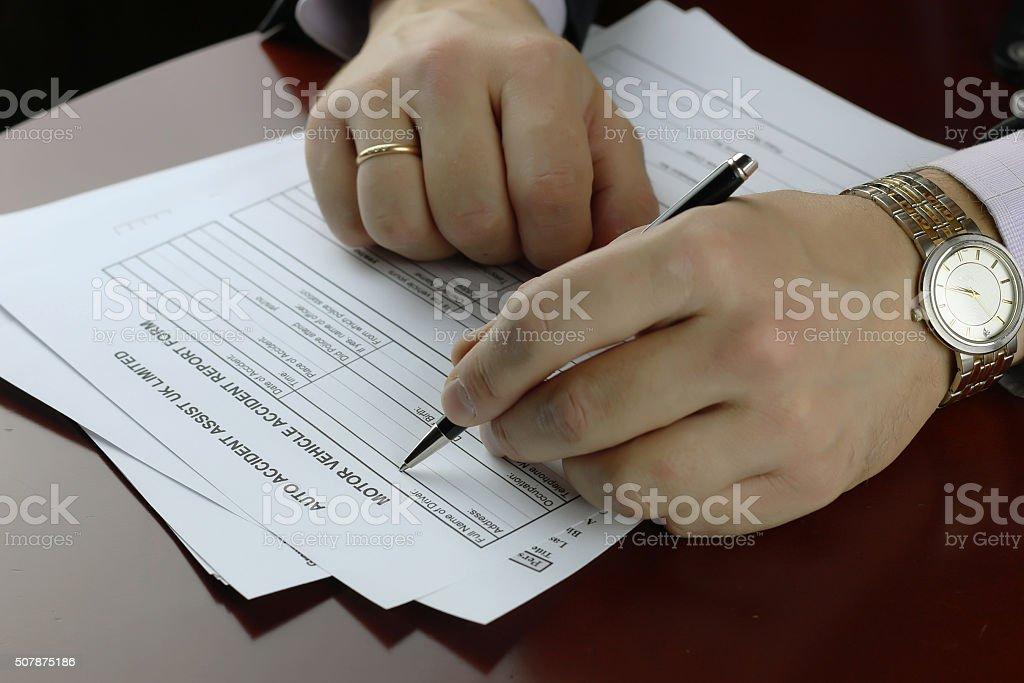 hand signature form car accident stock photo