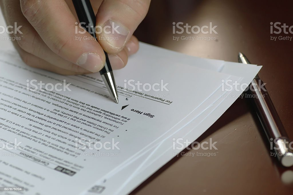 hand signed tax form stock photo