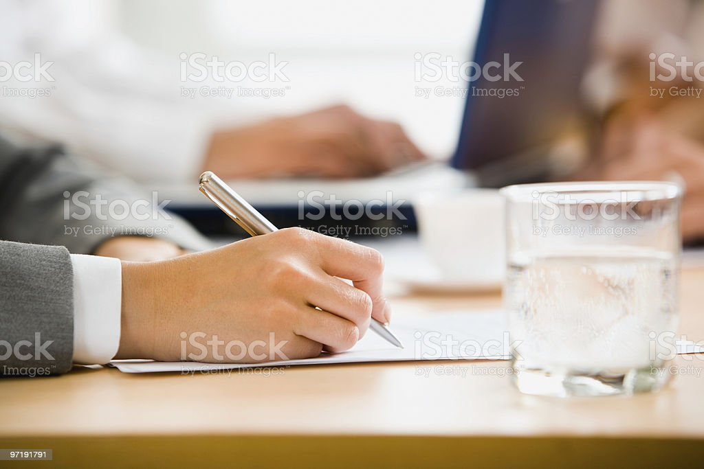 Hand signing a document stock photo
