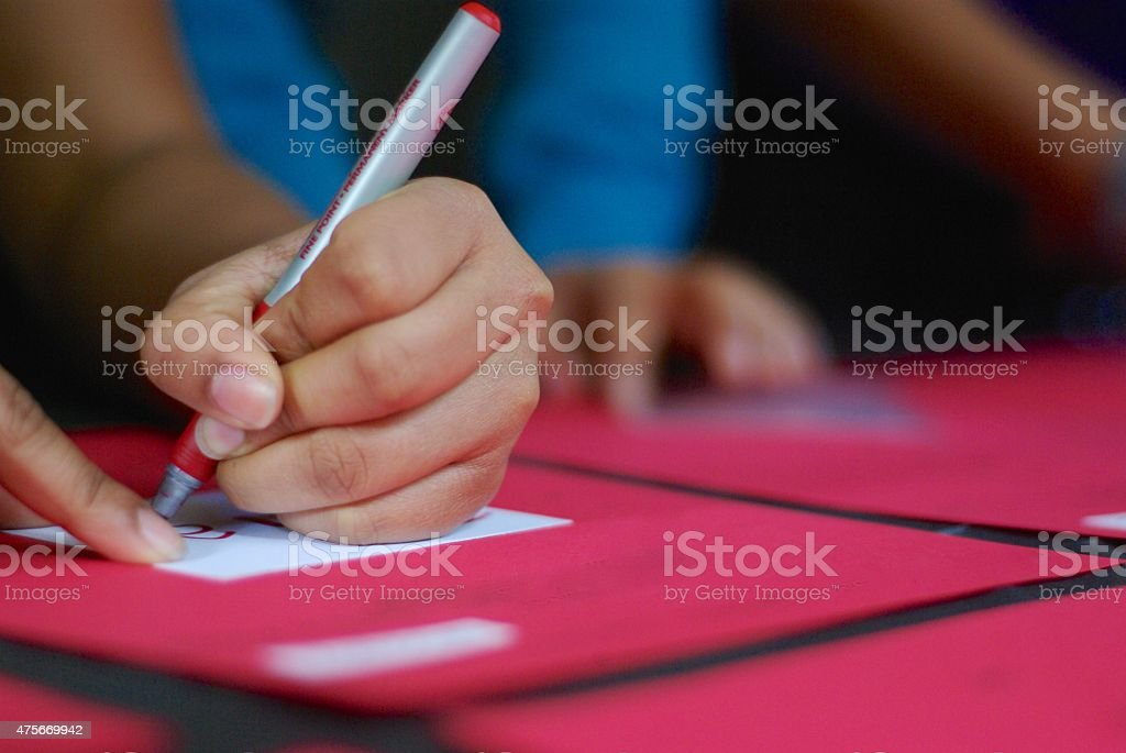 hand signing paper stock photo