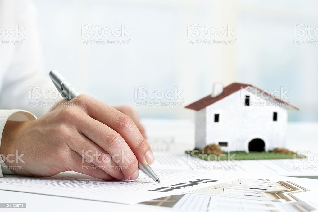 Hand signing real estate contract. stock photo