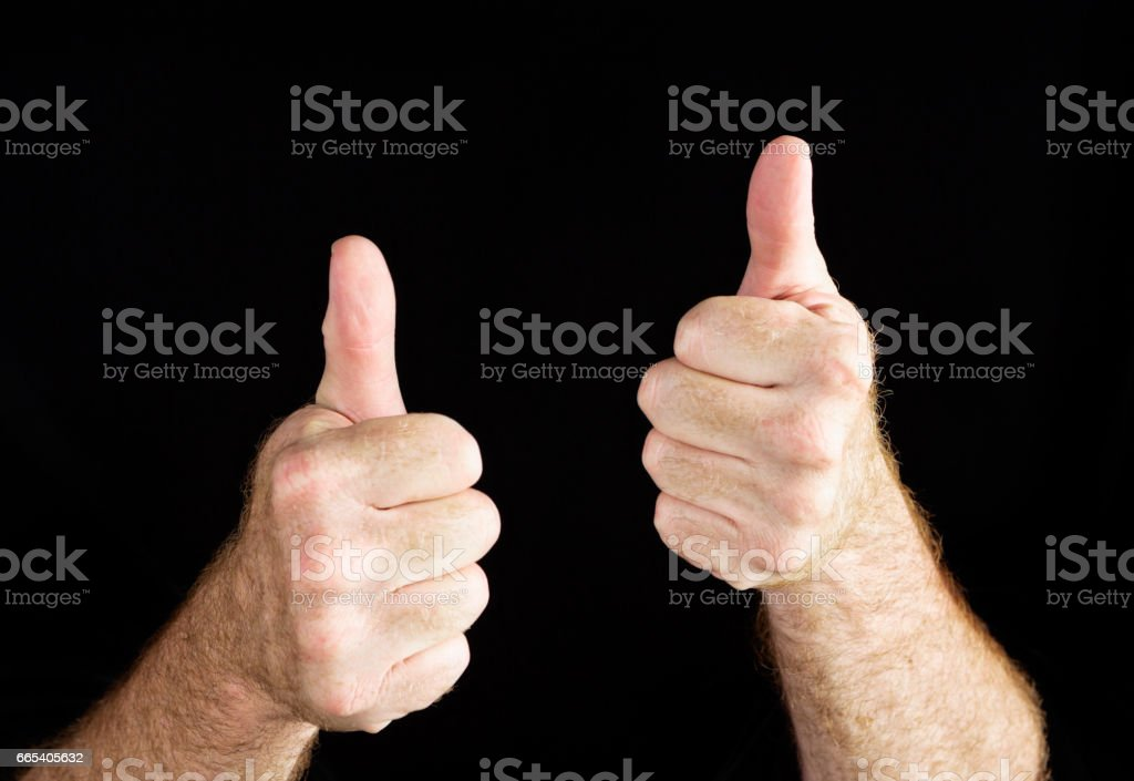 Hand signs: Two thumbs up on black stock photo