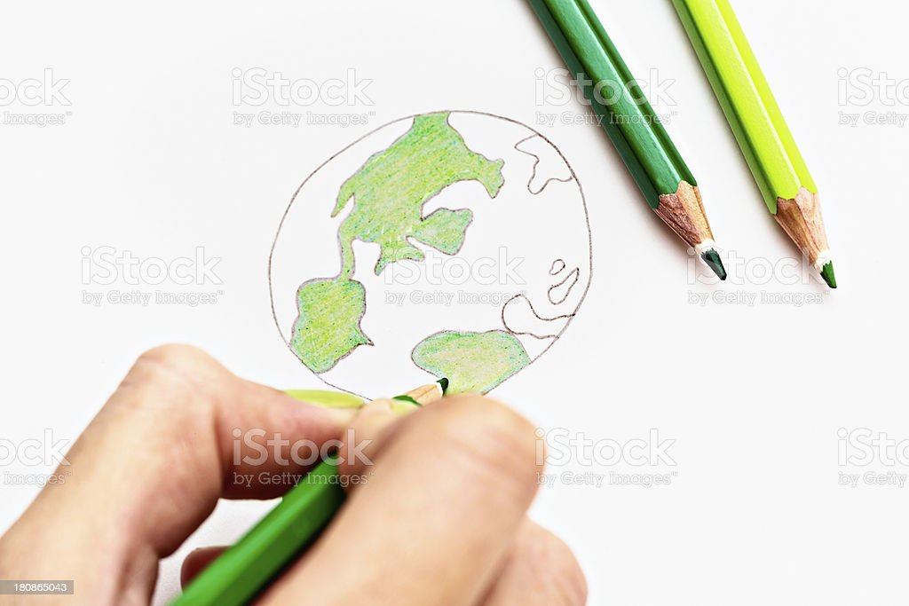 Hand sketches world map in green pencil crayons royalty-free stock photo