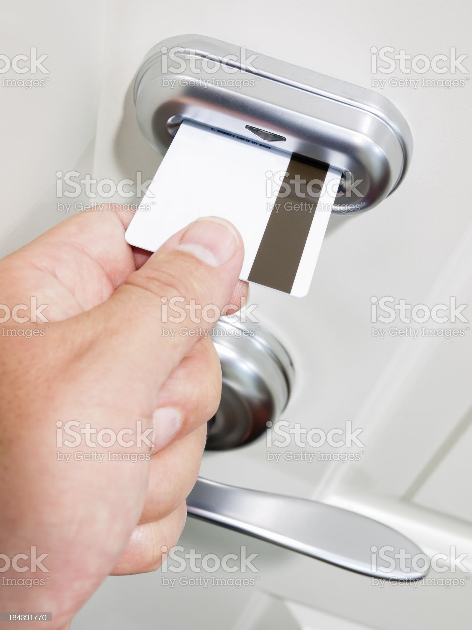 Hand Sliding Card Key Into Electronic Door Lock royalty-free stock photo