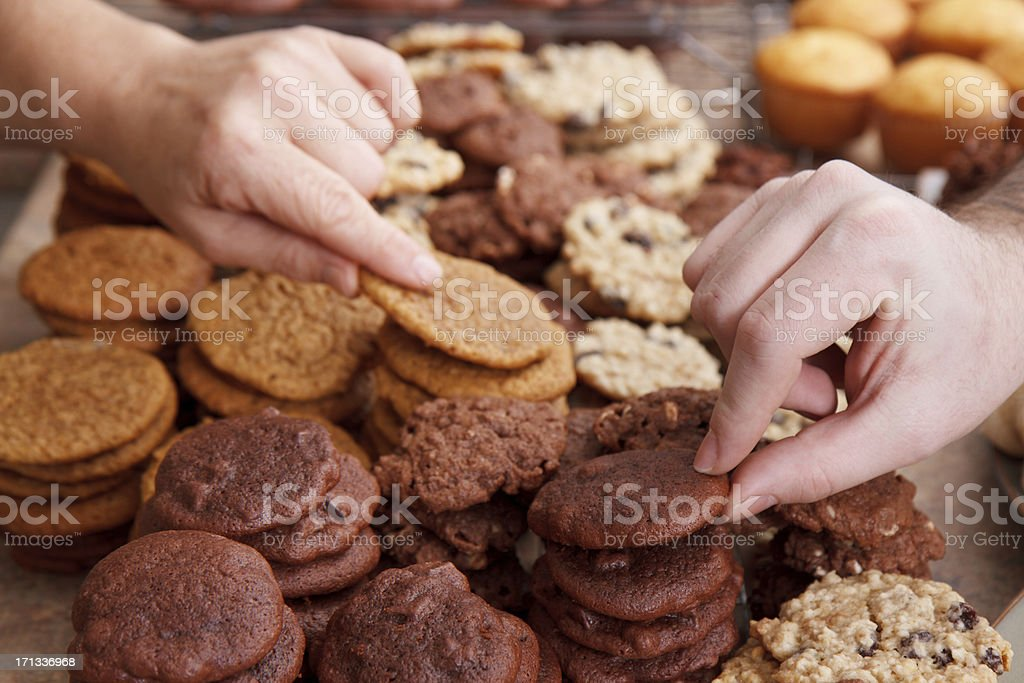Hand Sneaking Freshly Baked Cookies royalty-free stock photo