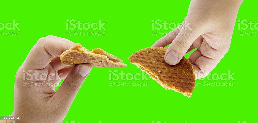 hand split stroop wafle stock photo