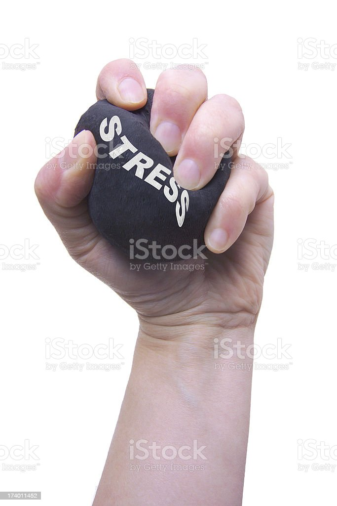 Hand squeezing a stress ball stock photo