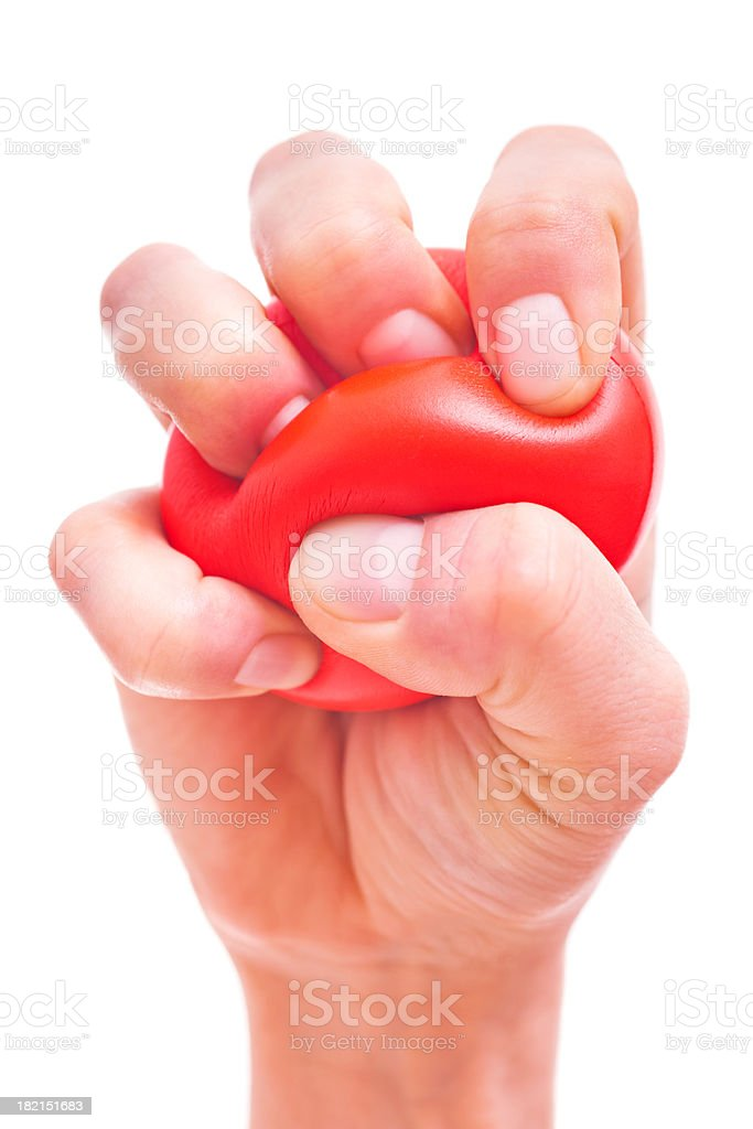 Hand Squeezing Stress Ball royalty-free stock photo