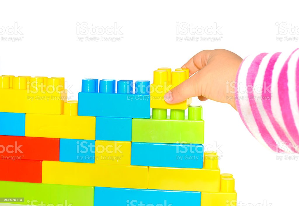 hand stack up lego set as a wall on white stock photo