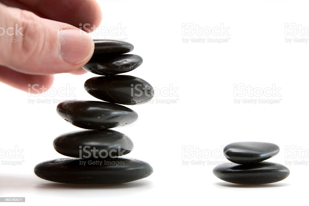 Hand stacking Pebbles royalty-free stock photo