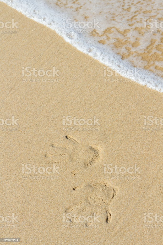 hand stamp on the sand stock photo