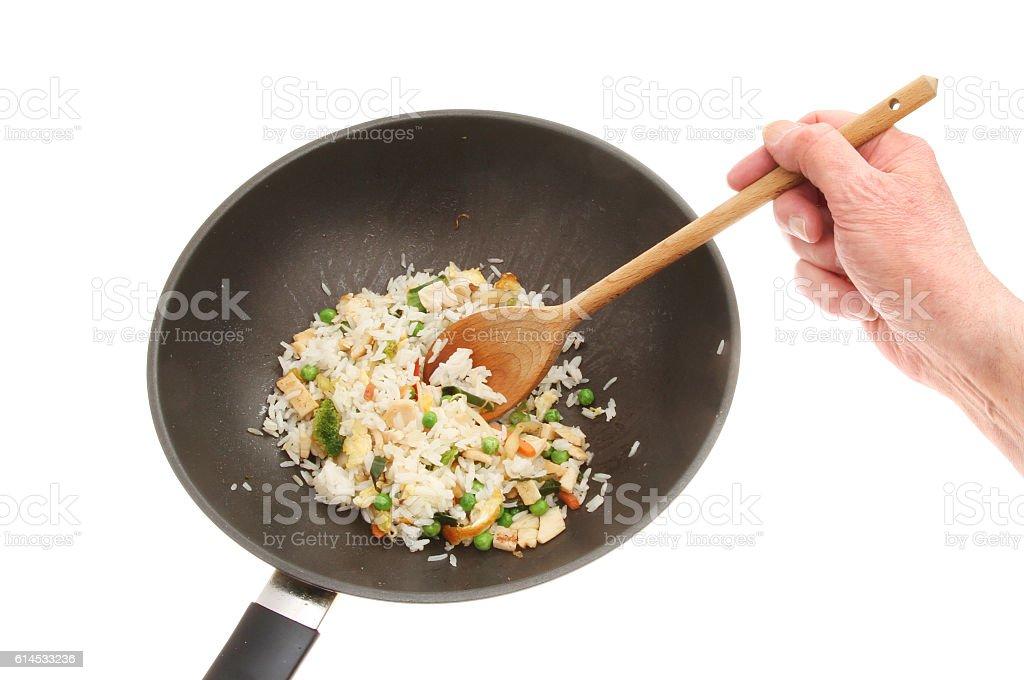 Hand stirring fried rice stock photo