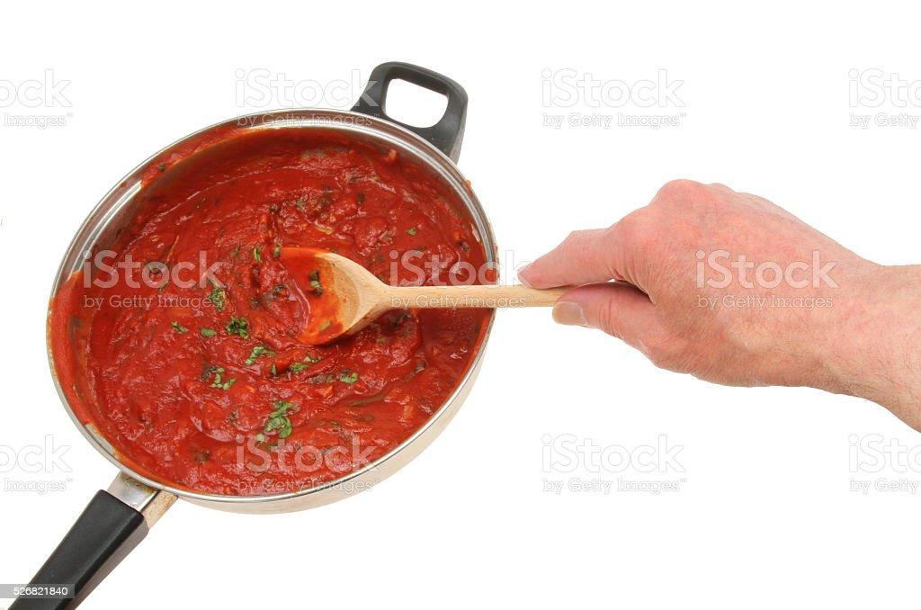 Hand stirring sauce stock photo