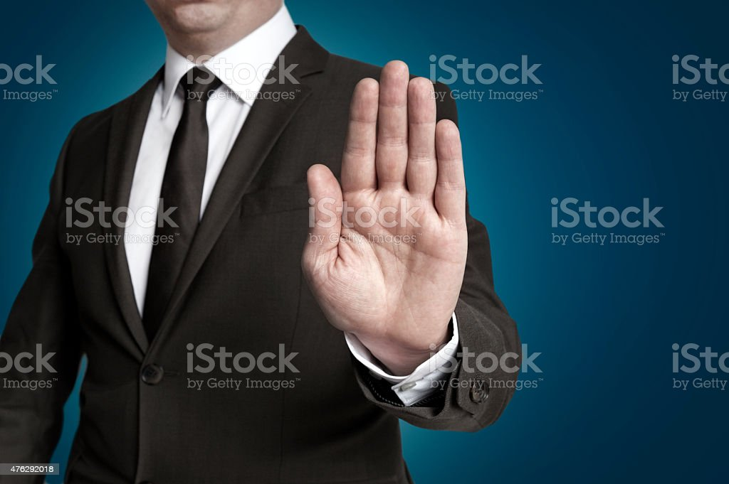 Hand stop shown by businessman stock photo