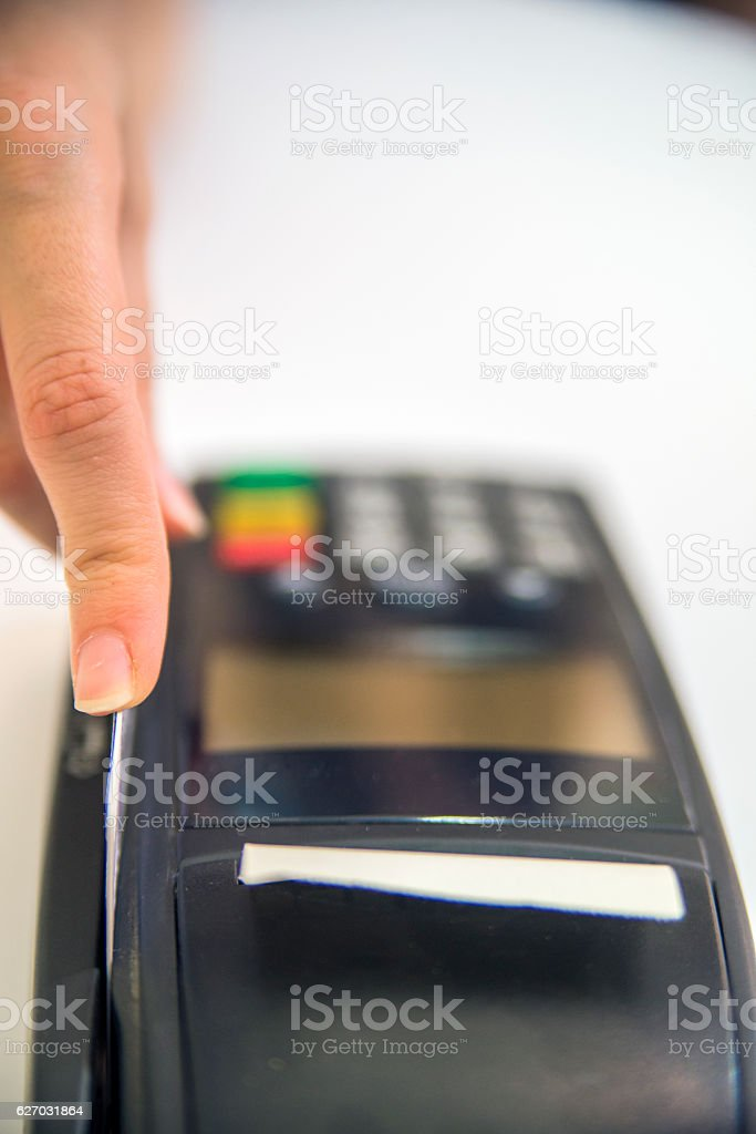Hand Swiping Credit Card In Store. stock photo