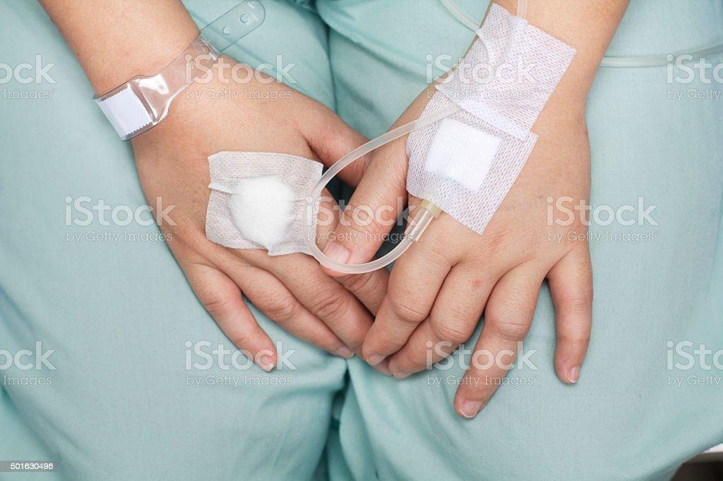 hand swollen by saline intravenous (iv). stock photo