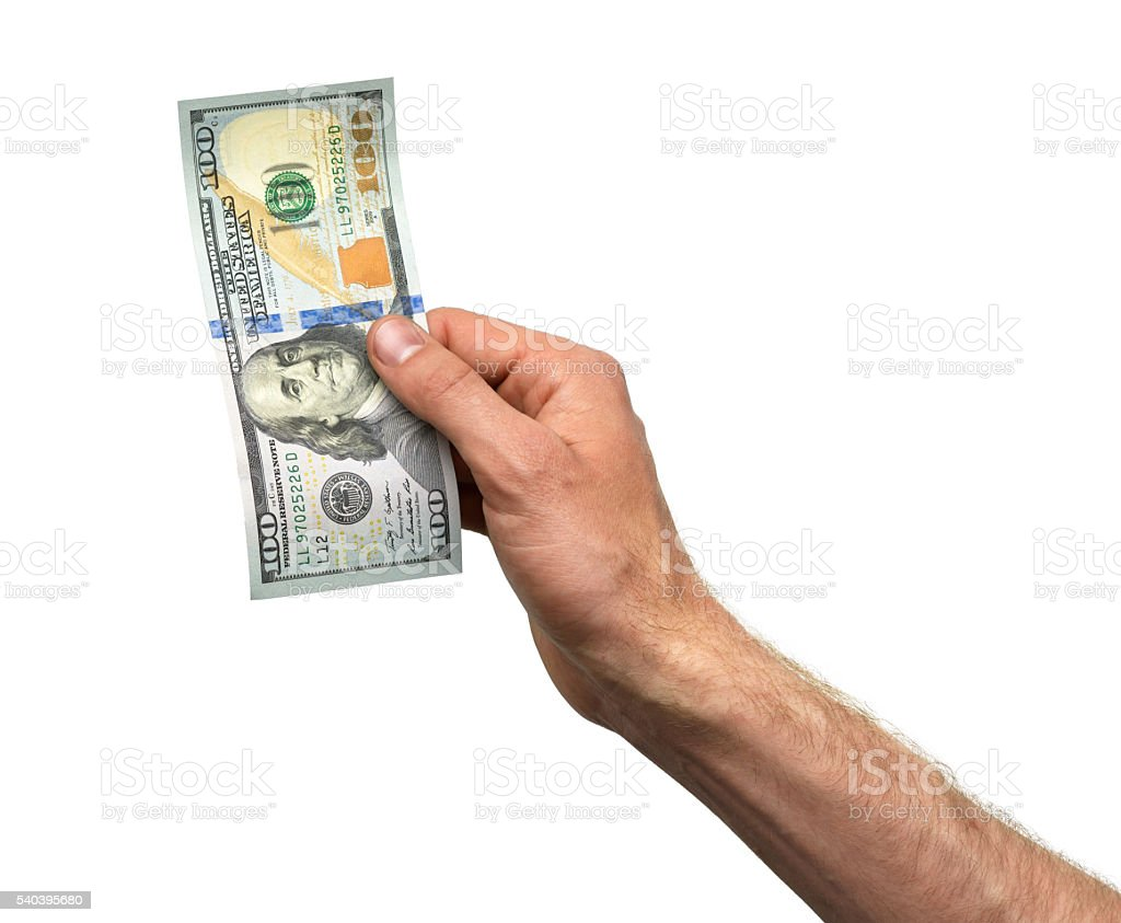 Hand takes 100 dollar bill stock photo