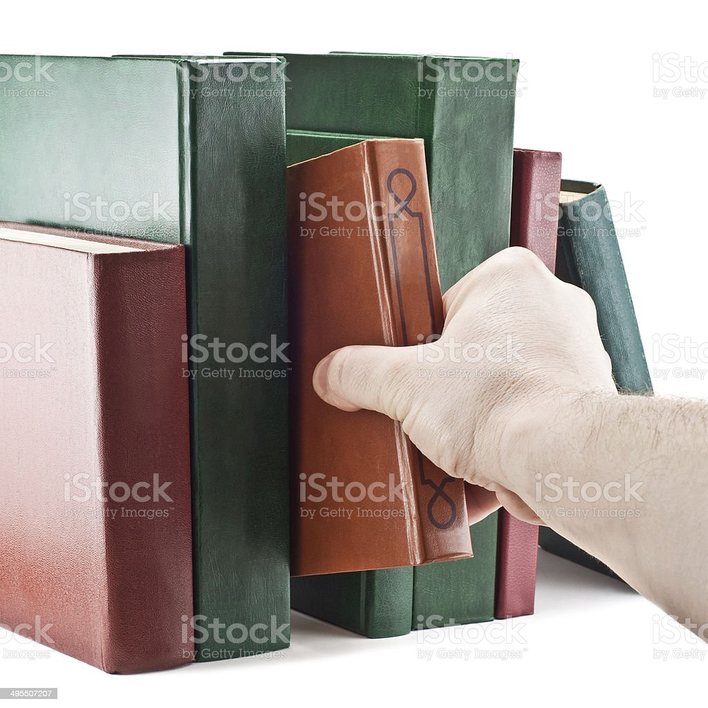 hand taking a book royalty-free stock photo