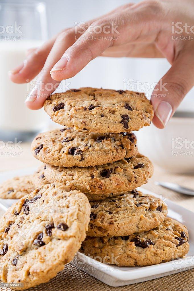 hand taking cookie stock photo