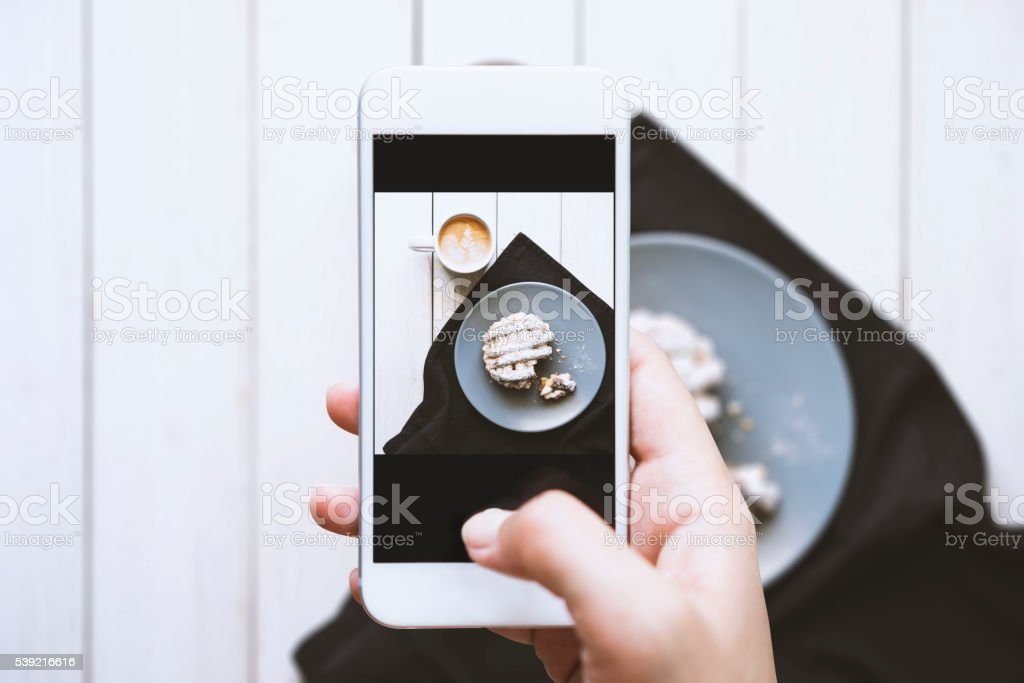 hand taking photo of tabletop stock photo