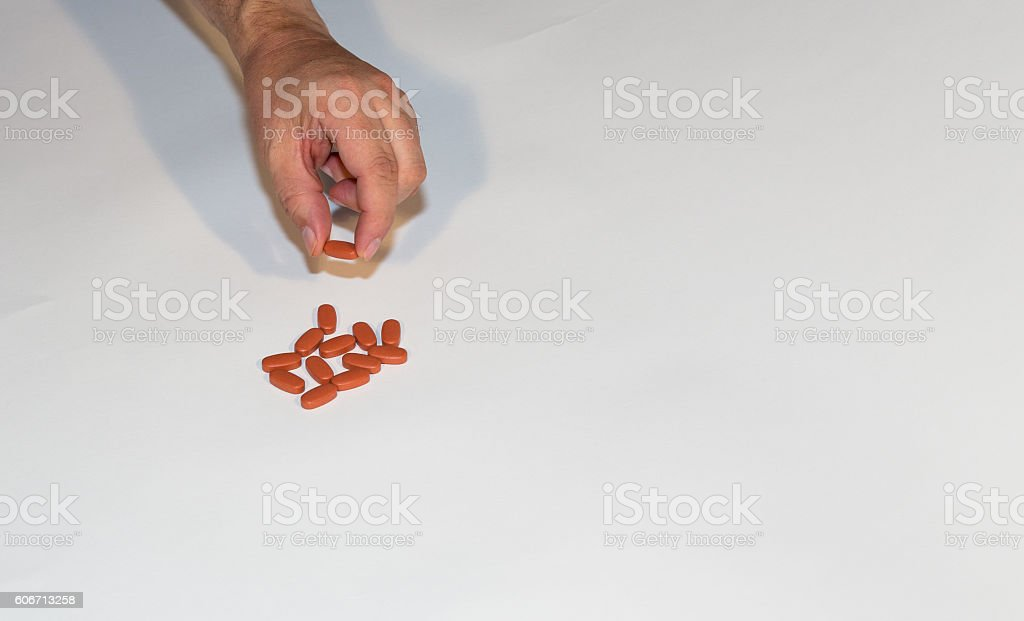 Hand taking pil. royalty-free stock photo