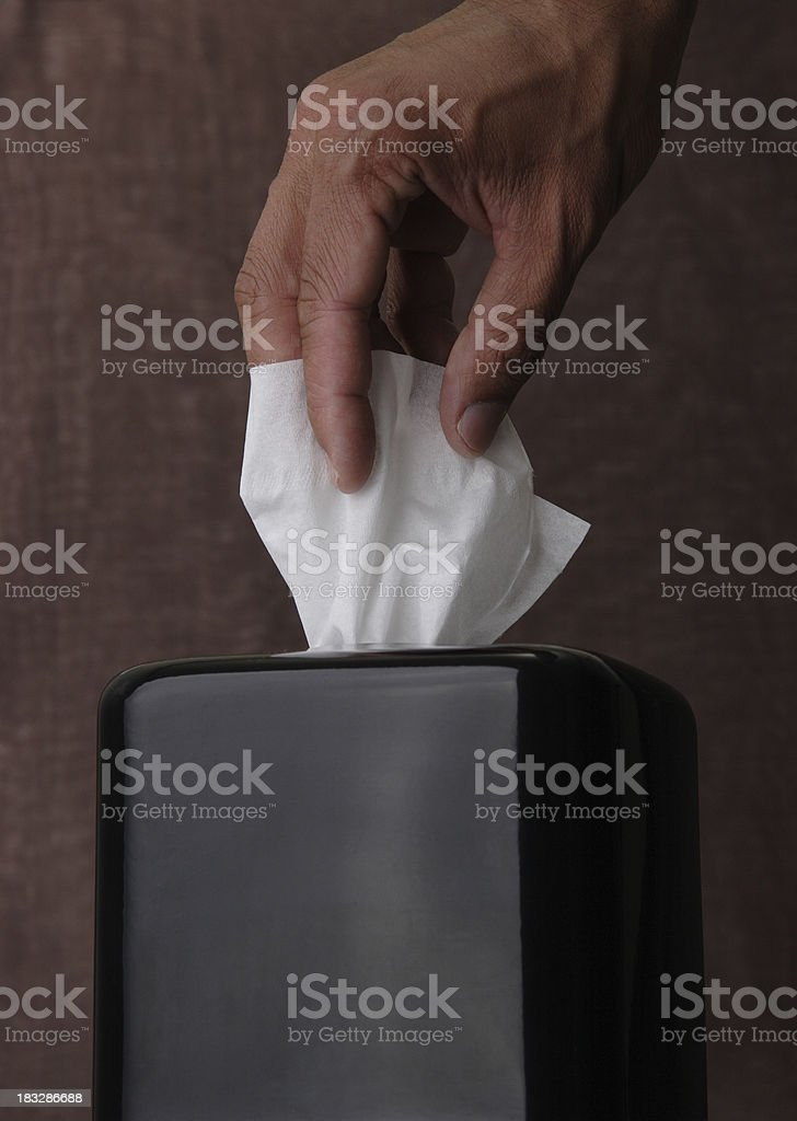 Hand Taking Tissue from a Box stock photo