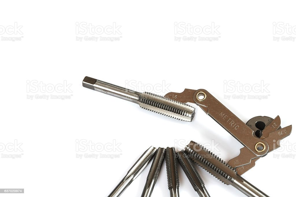 Hand tap (threading tool) with thread gauge. stock photo