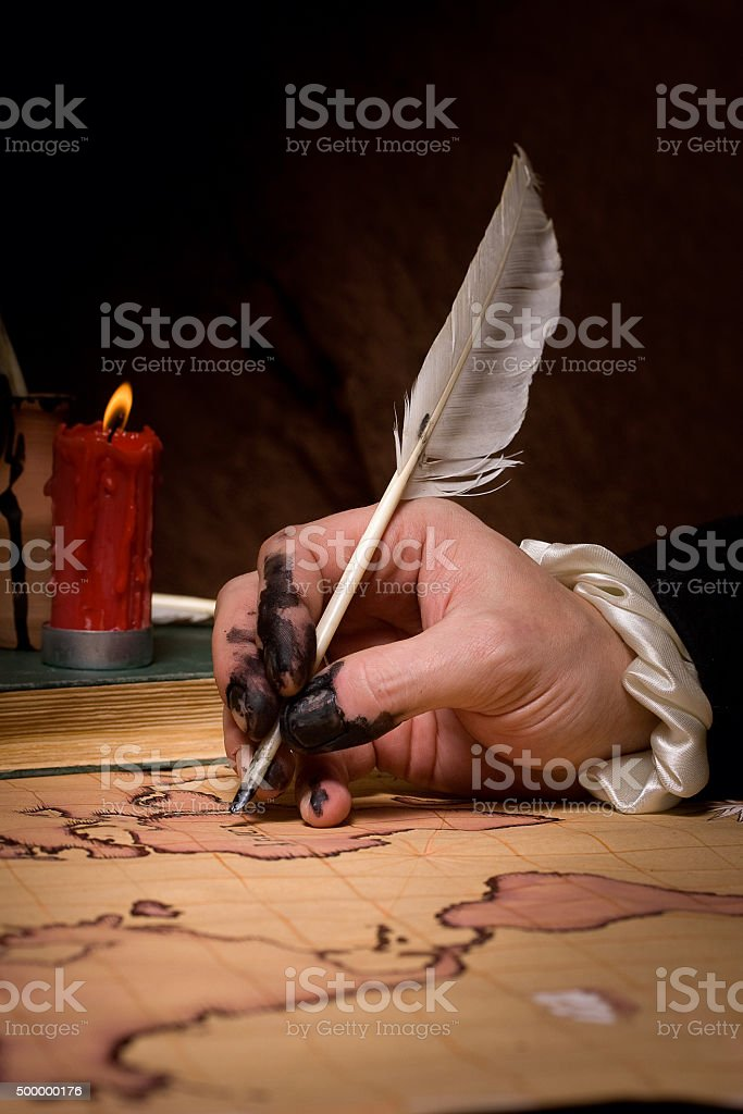 hand that draws the map stock photo