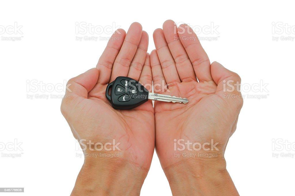 Hand the car keys on isolate white background stock photo
